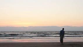 Men dancing on the beach. Unidentified men dancing on the beach stock video