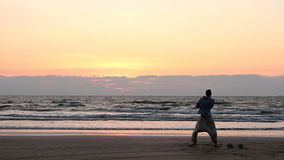 Unidentified men dancing on the beach. stock footage