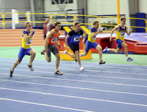 Unidentified men on the finish of the 60 meters Stock Photos