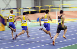 Unidentified men on the finish of the 60 meters Stock Image