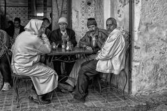 Unidentified men sitting in a bar in the street of Meknes, Morocco. Meknes is one of the four Imper. MEKNES, MOROCCO - FEBRUARY 18, 2017: Unidentified men Royalty Free Stock Images