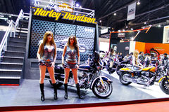 Unidentified model with Harley davidson. Bangkok - April 2 : Unidentified  model with Harley davidson -Street Glide-flstc-heritage-softail-classic- on display at Stock Image