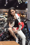 Unidentified model with Honda motorcycle. Stock Photo