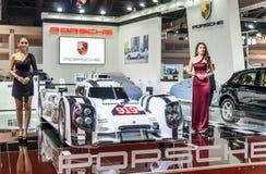 Unidentified Model with Porsche DMG MORI Royalty Free Stock Image