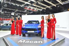 Unidentified model with Porsche Macan coupe on display at The 35th Thailand International Motor Expo on November 28 royalty free stock images
