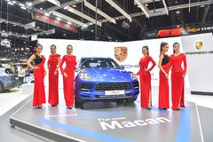 Unidentified model with Porsche Macan coupe on display at The 35th Thailand International Motor Expo on November 28 royalty free stock image