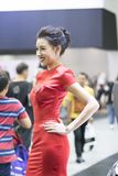 Unidentified model with presenters. Bangkok-Thailand-3 December 2017: Unidentified model with presenters Nissan booth at Motor Show Muangthong 2017 - The biggest royalty free stock images