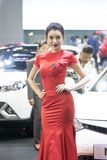 Unidentified model with presenters Nissan booth. Bangkok-Thailand-3 December 2017: Unidentified model with presenters Nissan booth at Motor Show Muangthong 2017 royalty free stock photos