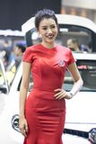 Unidentified model with presenters Nissan booth. Bangkok-Thailand-3 December 2017: Unidentified model with presenters Nissan booth at Motor Show Muangthong 2017 stock photos