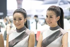 Unidentified model with presenters Nissan booth. Bangkok-Thailand-3 December 2017: Unidentified model with presenters Nissan booth at Motor Show Muangthong 2017 royalty free stock images