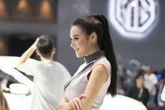 Unidentified model with presenters Nissan booth. Bangkok-Thailand-3 December 2017: Unidentified model with presenters Nissan booth at Motor Show Muangthong 2017 royalty free stock photography
