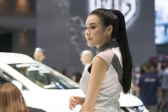Unidentified model with presenters Nissan booth. Bangkok-Thailand-3 December 2017: Unidentified model with presenters Nissan booth at Motor Show Muangthong 2017 Royalty Free Stock Photo