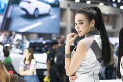 Unidentified model with presenters Nissan booth. Bangkok-Thailand-3 December 2017: Unidentified model with presenters Nissan booth at Motor Show Muangthong 2017 royalty free stock image