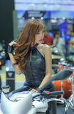 Unidentified model with Triumph motorcycle Royalty Free Stock Image