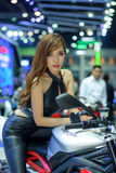Unidentified model with Triumph motorcycle Royalty Free Stock Images