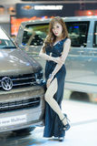 Unidentified model with Volkswagen. Royalty Free Stock Photo