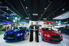 Unidentified modellings posted over Bentley Continental GT V8 and  Bentley GT speed Stock Image