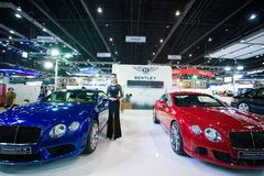 Unidentified modellings posted over Bentley Continental GT V8 and  Bentley GT speed Royalty Free Stock Image