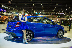 Unidentified modellings posted over  The new Proton Suprima S Stock Photography