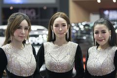 Unidentified 3 modellings present at Motor Show. Bangkok-Thailand-3 December 2017: Unidentified modellings present at Motor Show Muangthong 2017 - The biggest Royalty Free Stock Photography