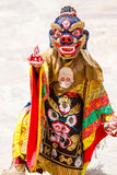 Unidentified monk performs a religious masked and costumed mystery dance of Tibetan Buddhism royalty free stock photo