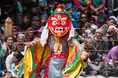 Unidentified monk performs a religious masked and costumed mystery dance of Tibetan Buddhism Stock Photo