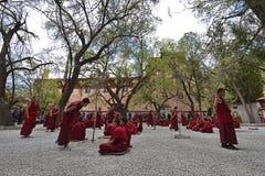 Unidentified monks debate at Sera monastery Stock Photo