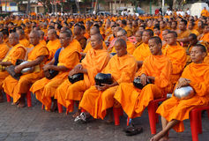 Unidentified monks wait the auspicious to walk to the public alm Royalty Free Stock Image
