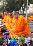 Unidentified monks wait the auspicious to walk to the public alm Stock Photo