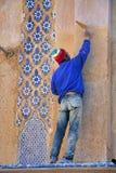 Morrocan man repair facade in a Fes Stock Photos