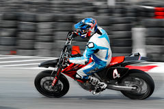 An unidentified moto rider. BUCHAREST, ROMANIA - OCTOBER 04: An unidentified rider participates in the Romanian Supermoto Championship on October 04, 2015 at Stock Photos