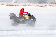 Unidentified motocross rider on quad bike. At Opening motocross season race. winter motocross. ATVs are riding in the field in the snow on the background of Stock Images