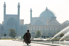 Unidentified Mullah walk towards the Shah Mosque in Isfahan Royalty Free Stock Image