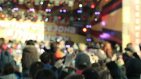 Unidentified music fans records the show. Shot on Canon 5D Mark II with Prime L Lenses stock footage