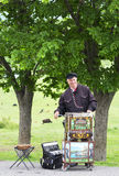 Unidentified musician plays on barrel organ at the market Stock Images