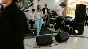 Unidentified musicians entertain customers. Kiev, Ukraine, March 2019: - Unidentified musicians entertain customers in the Sky Mall supermarket in Kiev on a stock video