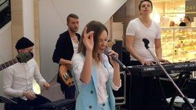 Unidentified musicians entertain customers in the Sky Mall supermarket. Kiev, Ukraine, March 2019: - Unidentified musicians entertain customers in the Sky Mall stock video