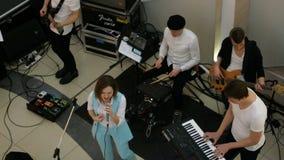 Unidentified musicians entertain customers in the Sky Mall supermarket. Kiev, Ukraine, March 2019: - Unidentified musicians entertain customers in the Sky Mall stock footage