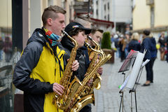 Unidentified musicians play Saxophone Royalty Free Stock Photos