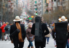 Unidentified musicians walking in the middle of Sants Street before carnival parade Stock Photos