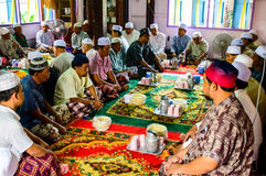 Unidentified Musim senior men pray for Allah for ceremony in Graduation of the Quran. Stock Photo