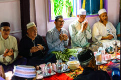 Unidentified Musim senior men pray for Allah for ceremony in Graduation of the Quran. Stock Photos