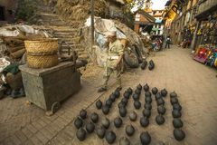 Unidentified Nepalese man working in the his pottery workshop. Royalty Free Stock Photo