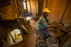 Unidentified Nepalese man working in the his pottery workshop. Stock Images