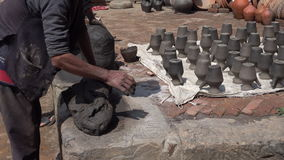 Unidentified Nepalese man working in the his pottery workshop. stock video footage