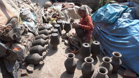 Unidentified Nepalese man working in the his pottery workshop. stock footage