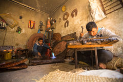 Unidentified Nepalese tinman working in the his workshop Stock Image