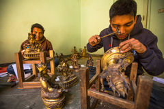 Unidentified Nepalese tinman working in the his workshop Royalty Free Stock Photography