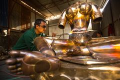 Unidentified Nepalese tinman working in the his workshop. Stock Photography