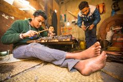 Unidentified Nepalese tinman working in the his workshop. Royalty Free Stock Photography